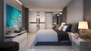 Optoma soundbar en beamer op muur in slaapkamer